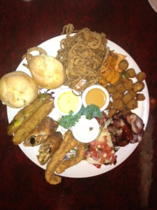 Soul food and more: Biscuits, Fried Okra, Fried Green Tomatoes, Straw Onion Rings, Fried Dill Pickles, Spring Rolls, BBQ Tri Tips, Chicken Strips, and Quesadillas with BBQ beef inside.