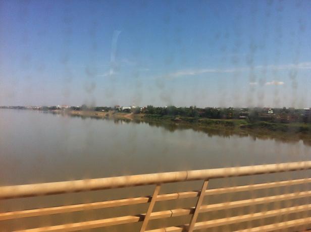 a view from the Friendship bridge through a dirty bus window