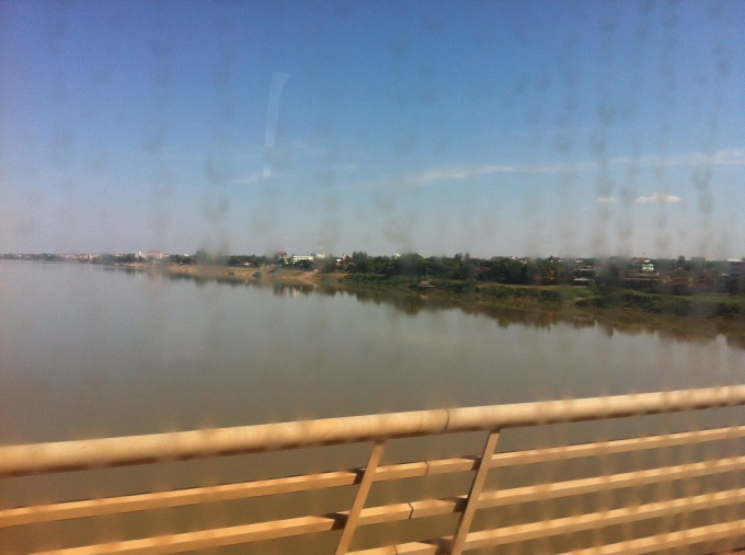 a view from the Friendship bridge through a dirty bus window