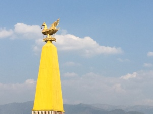 votive monument in front of every inle village